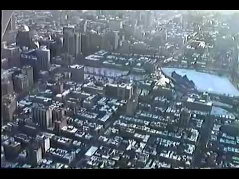 HQ Flying over Montreal downtown Mont-Royal Olympic Stadium. To play HQ add &fmt=18 at end of url.