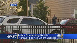 Police Conduct Raid In Search For Suspect Who Shot ATF Officer