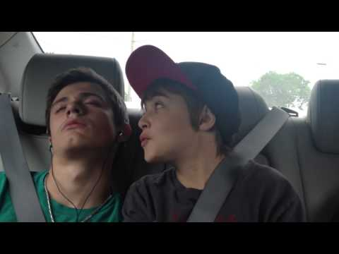 Younger brother sings to older sleeping brother in car