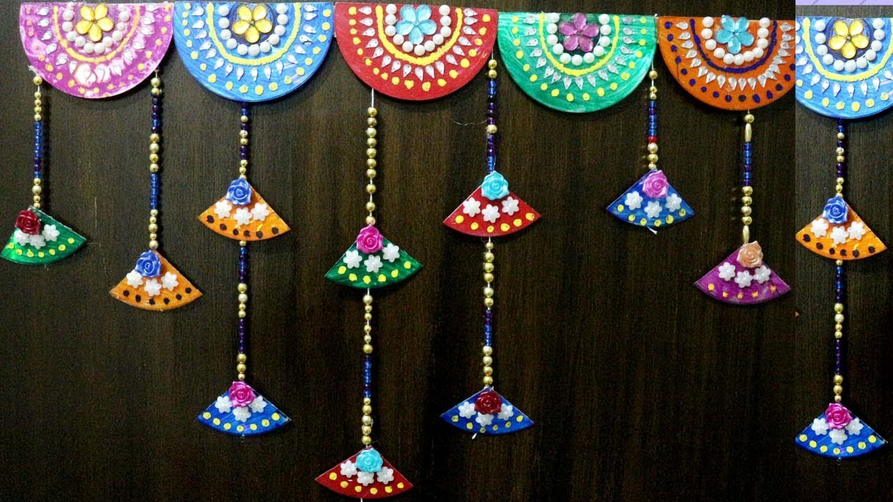 Best out of the waste wall hanging bandhanwar door for Wall hanging best out of waste