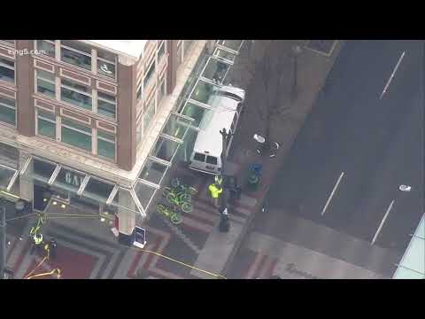 Four hurt after van into building in Seattle