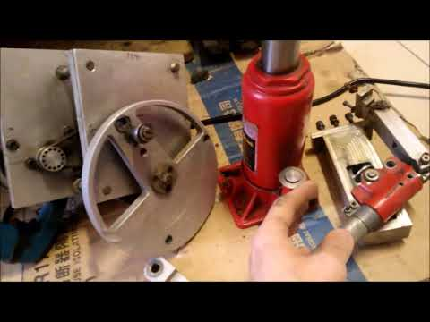 Electrical to hydraulic power mechanism for injection molding machine (Generation II)