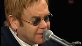 Sir Elton John sings
