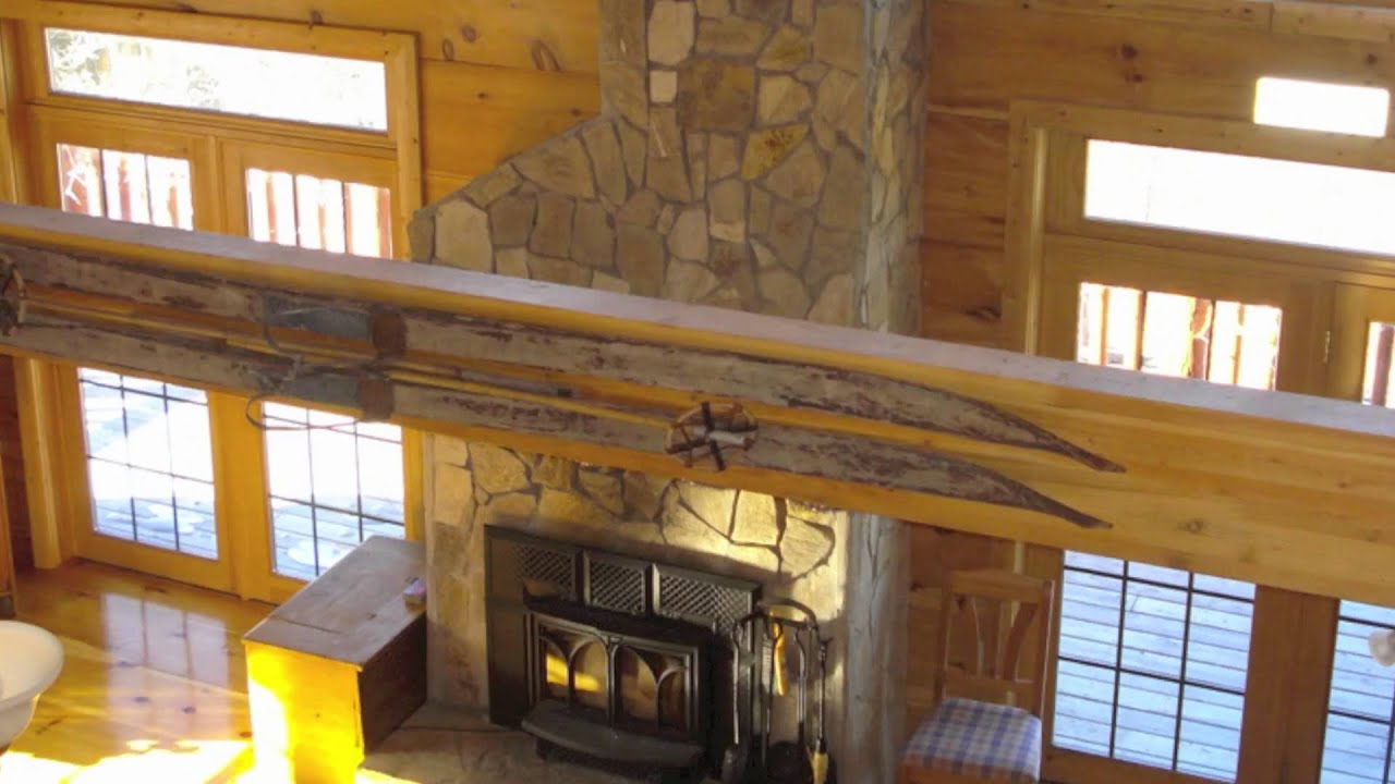 hewn salmon along one mountains nh cottages hand new rustic original atmosphere hampshire s our cottage serene kind authentic log rentals the in of hole cabins offer fireplace brook nestled white a