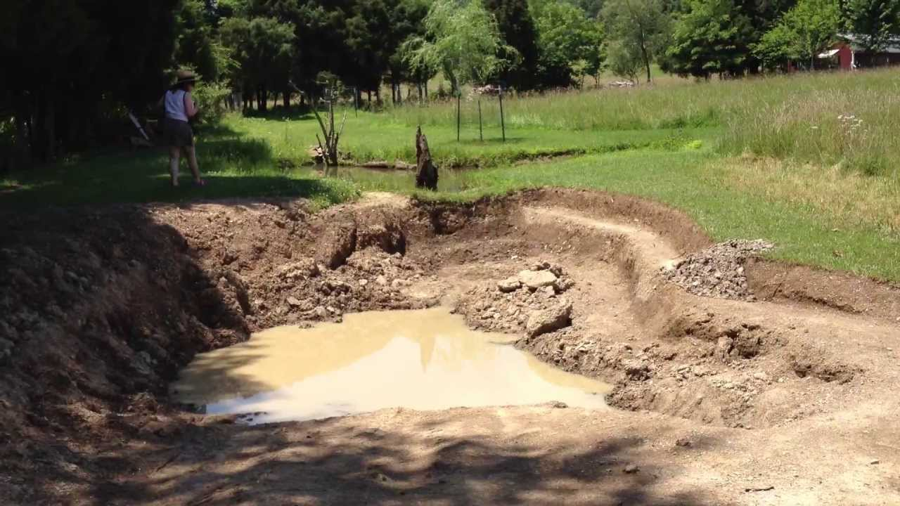 Fishing pond expansion progress lining with clay youtube for Small pond construction