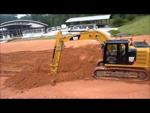 Cat 316E Excavator Digging Dirt