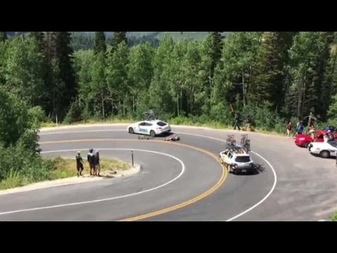 Cyclist Racing Downhill Crashes Into Car