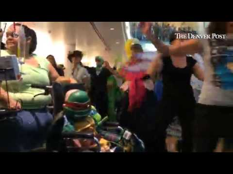 Staff at Children's Hospital Colorado in Aurora  perform a Halloween flash mob in the atrium of the
