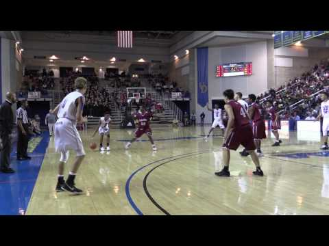 St Thomas More #4 Eric Montanez with a great move to the basket for the layup