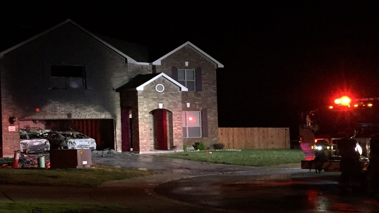 Two vehicles parked in garage burn in NW Bexar County house fire