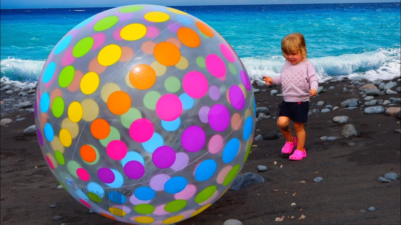 Alex and Dad play with a giant ball and have a pretend play picnic on beach. Fun playtime for kids.