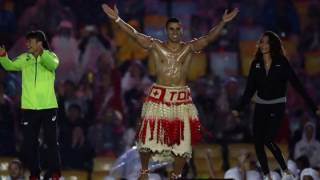 Pita Taufatofua of Tonga jumps on stage during the Closing Ceremony of Rio 2016