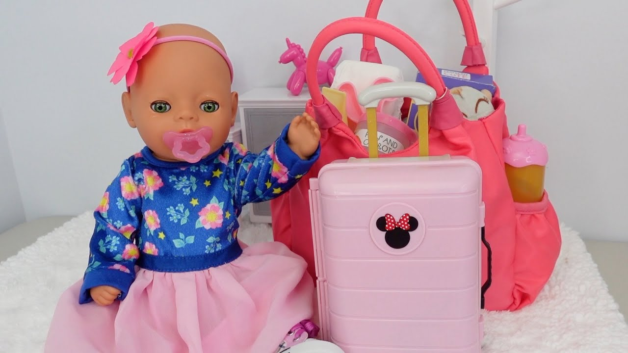 Baby Born Lil Girl Feeding and packing for vacation packing baby Doll diaper bag and suitcase