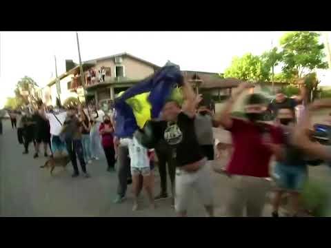 Maradona's fans pour onto streets to greet casket