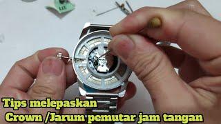 Cara melepas jarum pemutar jam tangan Analog