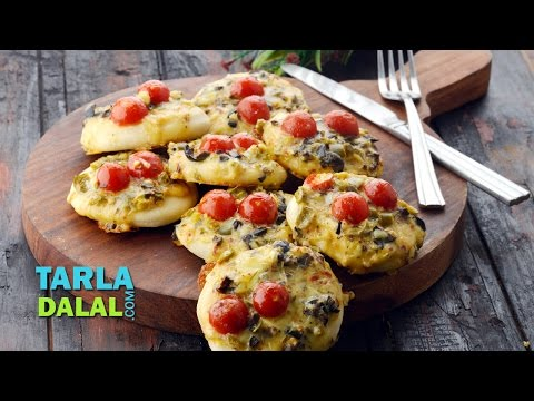 Mini Pizza Topped with Olive, Jalapeno and Cherry Tomato by Tarla Dalal