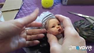 Розпакування на волоссячко  міні Реборн