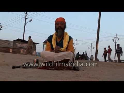 Sadhu meditates at Triveni Sangam during a Hindu Festival in India