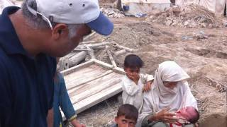 Habib Malik with Khadeja in Lunda village, Charsadda,  Pakistan floods
