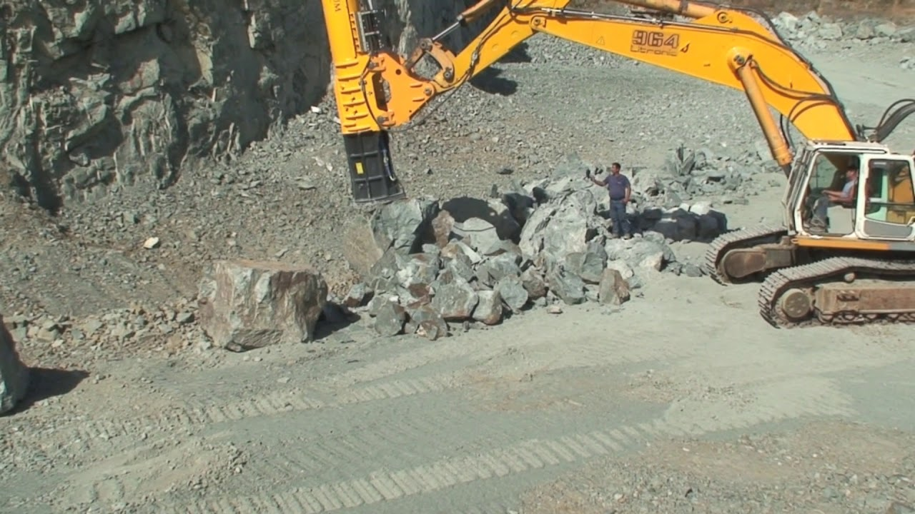 Fractum drop ball breaker breaking oversized boulders in quarry