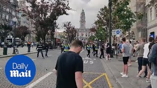 England football fans clash with police in Portugal