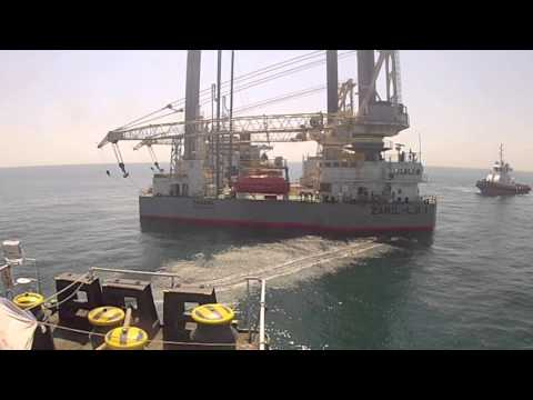 semi submersible ship discharging its cargo