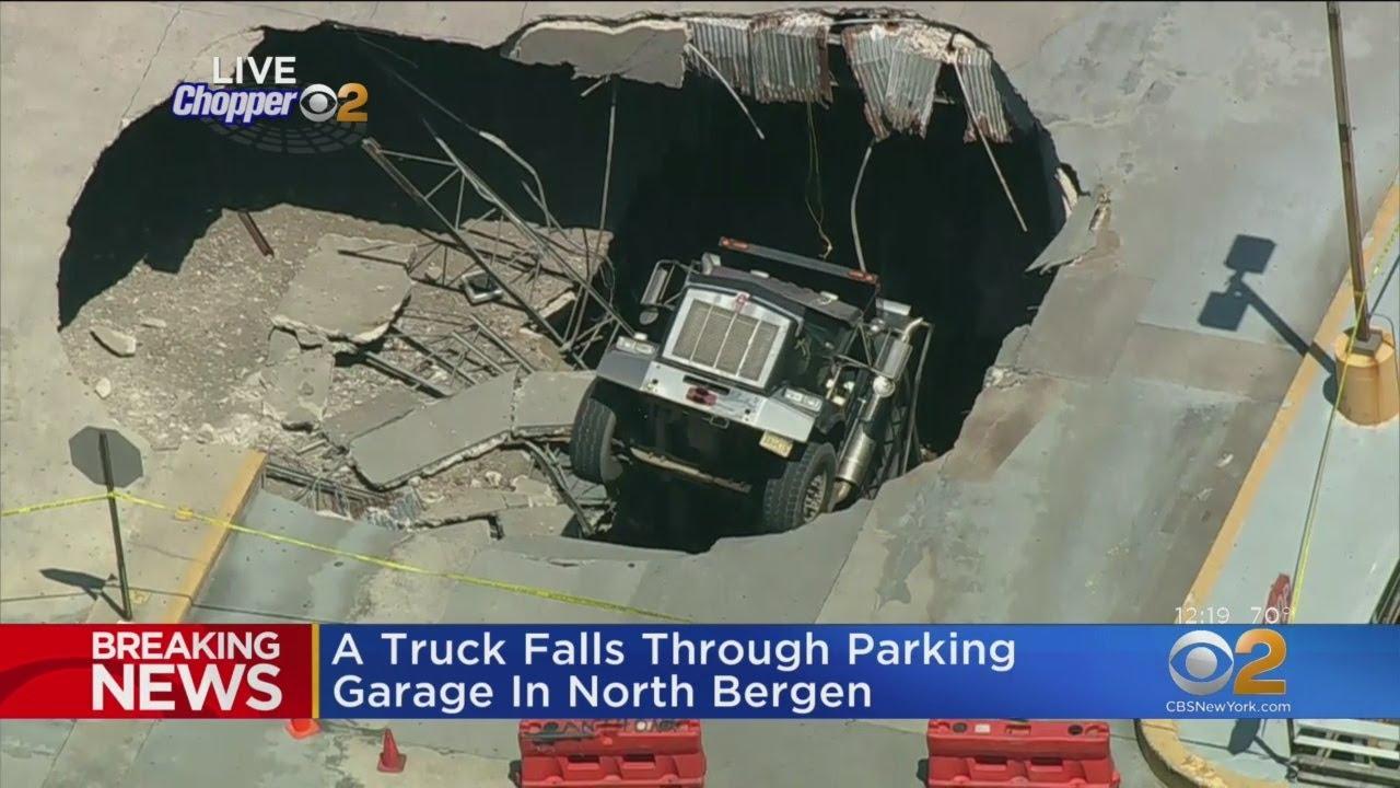Truck Falls Through Parking Garage In North Bergen