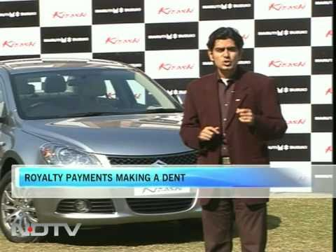Maruti launches Kizashi, but worried over margins