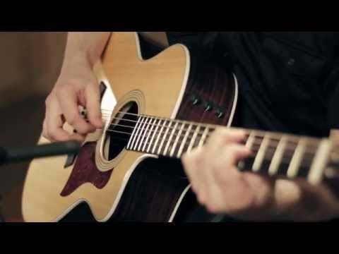 Product Spotlight - Taylor 214ce Deluxe Grand Auditorium Cutaway Acoustic Guitar