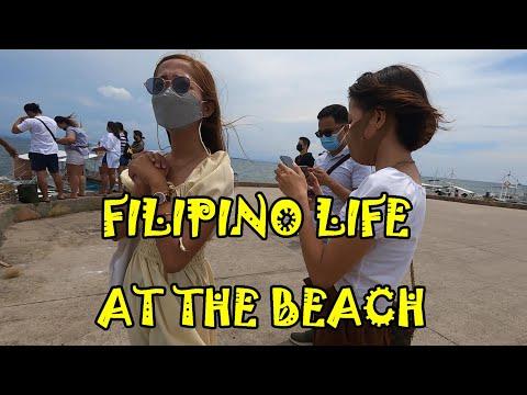 FILIPINOS ENJOYING LIFE AT THE BEACH, MACTAN, CEBU, PHILIPPI