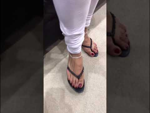 Sexy indian feet in thong heels with red toe nails thumbnail