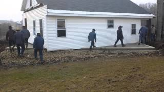 80 Mennonites pick up and move a house