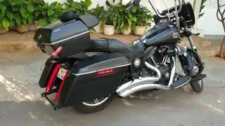 Touring box, side box panniers, highway footboards,windshield on a Harley Davidson Street Bob