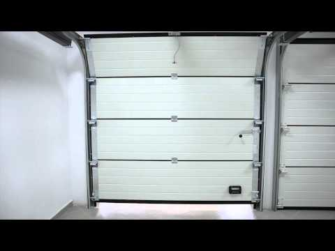Fabrication porte de garage sectionnelle funnydog tv for Porte de garage mca