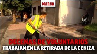 Voluntarios trabajan en la retirada de la ceniza volcánica de las calles y casas de La Palma I MARCA
