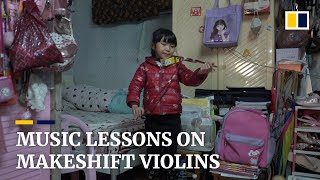 Pencils and a tea box: makeshift 'violins' help underprivileged music students during the pandemic