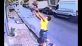 Teenager catches toddler falling from second-floor window