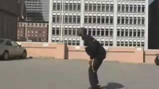 Kobe Bryant jumps over a speeding car (Aston Martin)