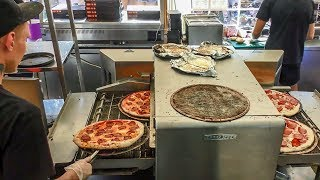 Fast Food Pizza. Automatic Machine Cooking Pizza. Minsk Street Food, Belarus