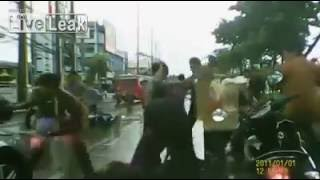 Gang war brawl breaks out onto the street in Thailand dashcam