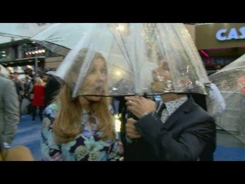 Zack and Deborah Snyder caught in umbrella collapse