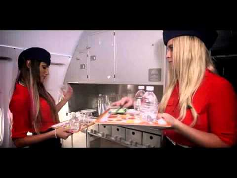 Sexy air hosts serving the passengers in plane thumbnail