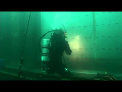 Diver Working Below Dam's Spillbay Apron
