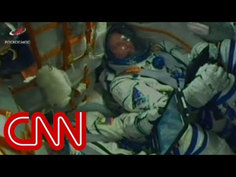 Astronauts react inside rocket during emergency landing