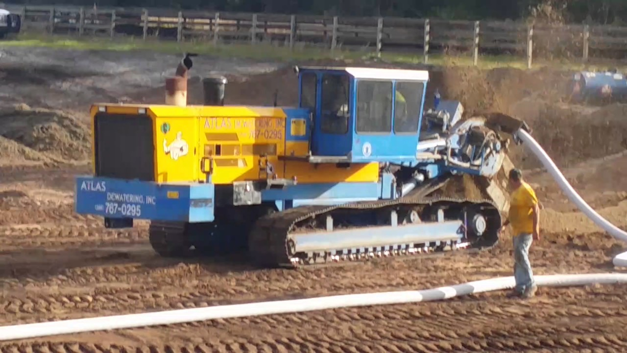 Trenching in sock drain to dewater order make