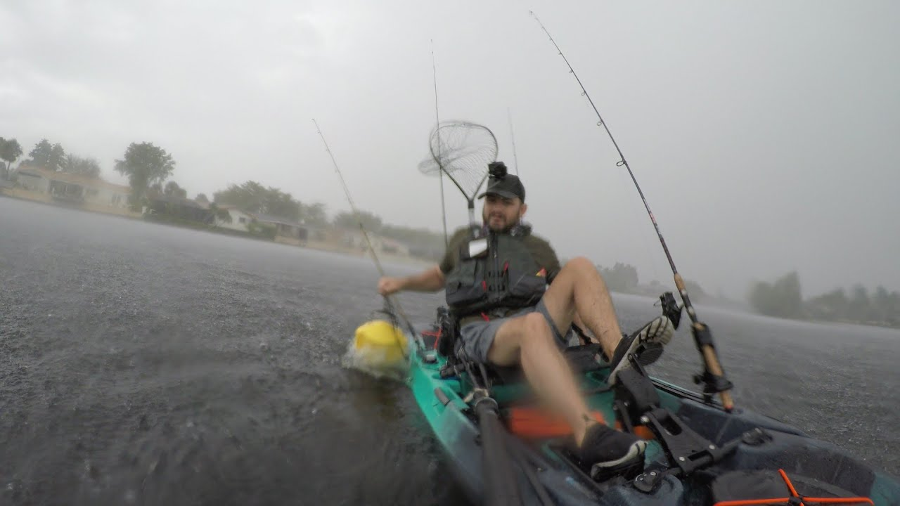 Crazy anglers kayak fishing under a storm - Old Town Top Water PDL