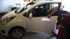 Safelite Autoglass Technician vacuums glass out of 2013 Chevrolet Spark Door, 4 June 2014, 00011