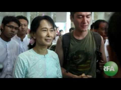 Aung San Suu Kyi greets son Kim Aris