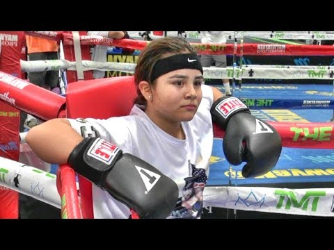 Young high school student Breanna learning to box inside the Mayweather Boxing Club