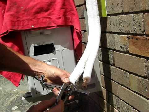 Air Conditioner Installation Cut Pipe With A Pipe Cutter